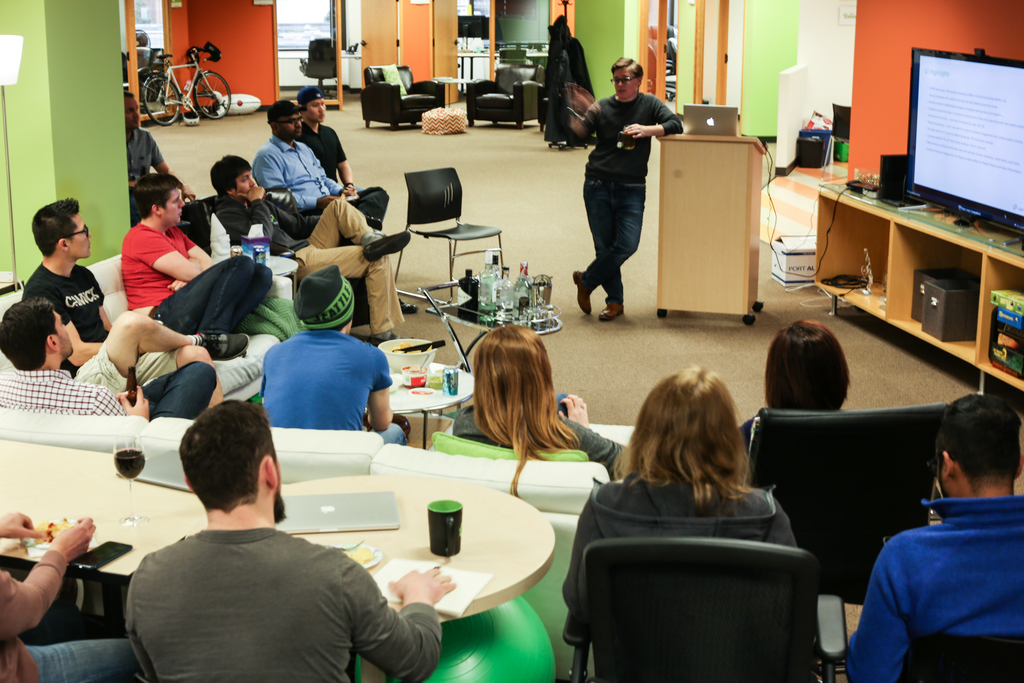 Michel Feaster, Co-Founder and CEO of Usermind, talks during team stand-up meeting